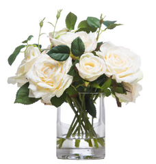 faux white roses in glass vase and water like