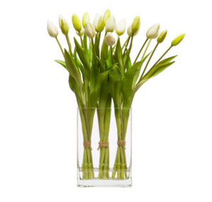 faux white tulips arrangement in glass vase water like