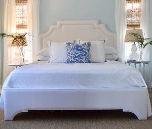 Jackson bed headboard and frame with throw pillows lamps and bedside tables