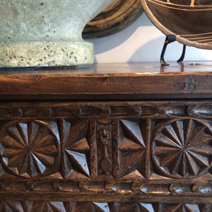 detail of hand carving on spanish console