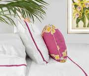 luxury bed linens with orchid pin stripe on bed with throw pillow and antique botanical fine art print on wall