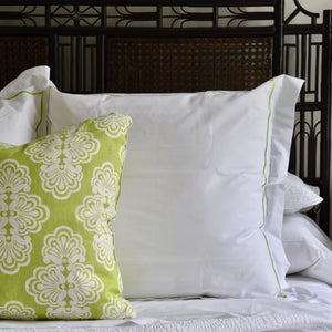 lime green lilly pulitzer shell we pattern throw pillow on bed with headboard and bed linens