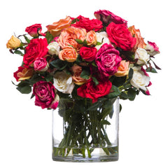 faux mixed roses in glass vase with water like