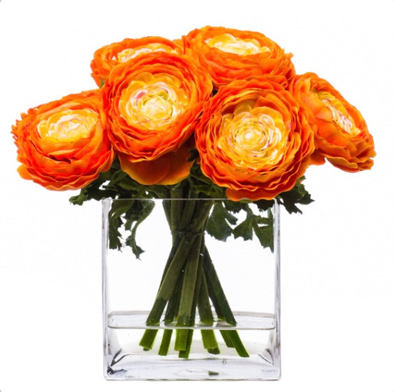 faux orange ranunculus in glass vase water like