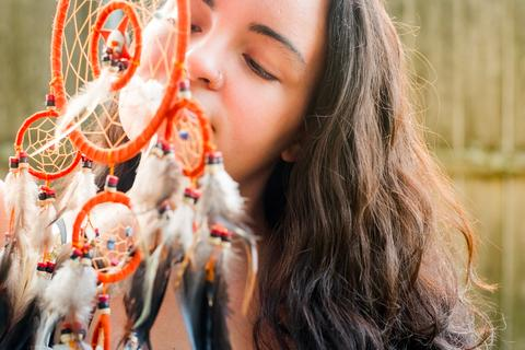 woman smelling dream catcher