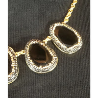 black pave necklace closeup view