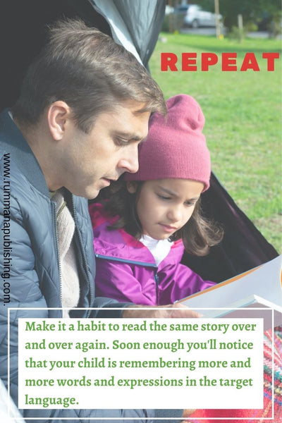 A Father is reading a story book for his daughter outside the tent