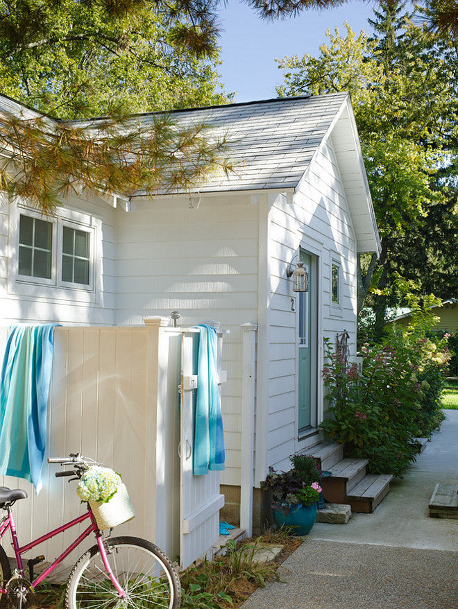 white cottage with towels