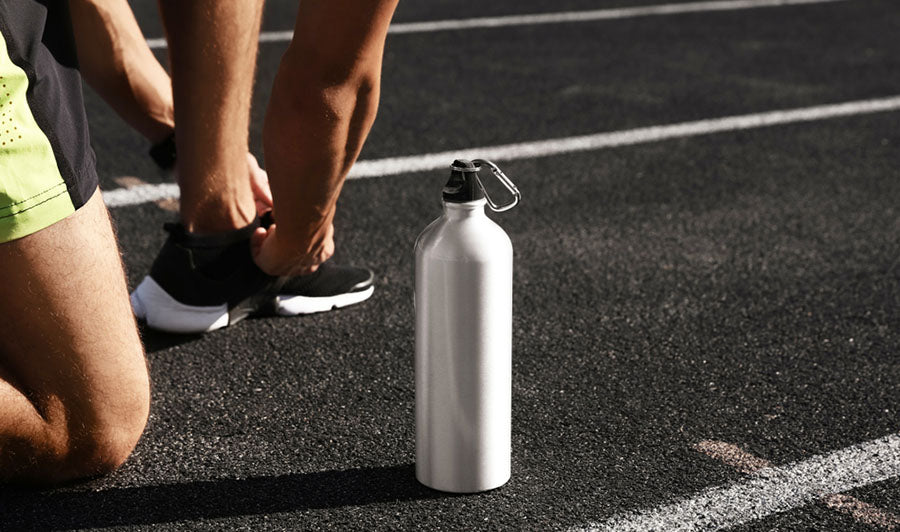 kneeling on pavement sports bottle
