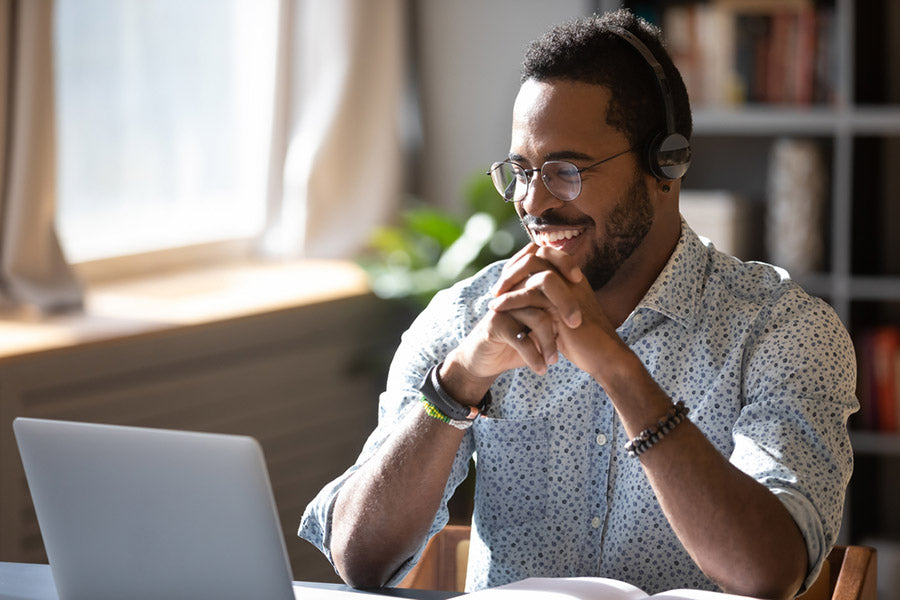 man in glasses on laptop