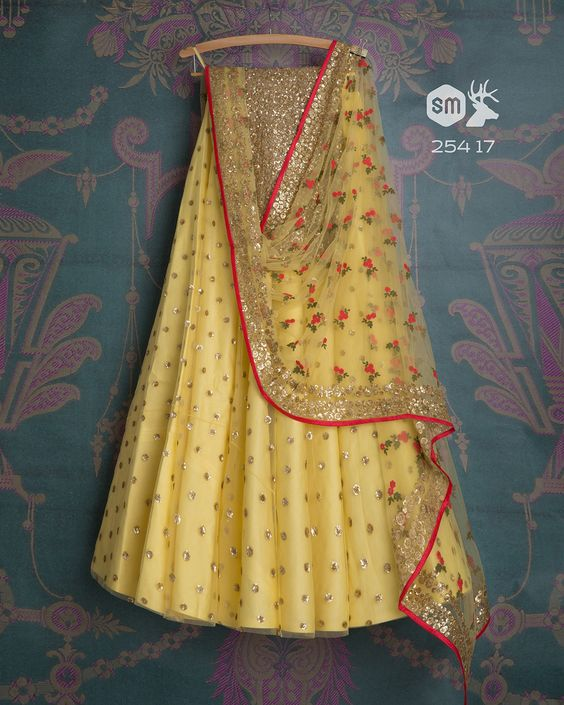Wonderful Yellow Color Party Wear Embroidered Net Lehenga Choli MDL1438