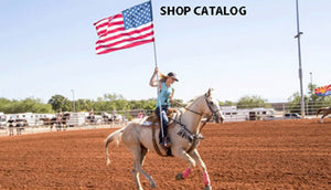 Image of rodeo girl riding horse with American flag