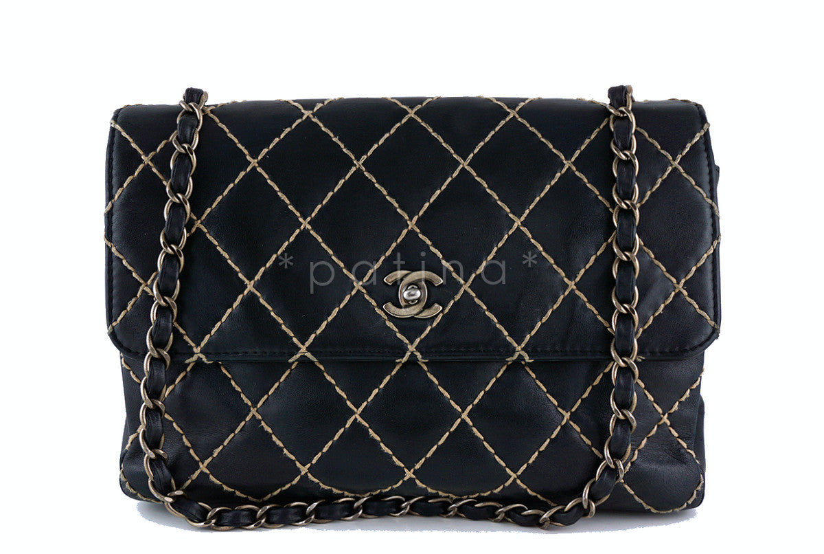 Chanel 12 in. Black Contrast Stitch Surpique Classic Jumbo Flap Bag