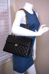 Chanel Black Lambskin Jumbo Quilted Classic 2.55 Flap Bag GHW