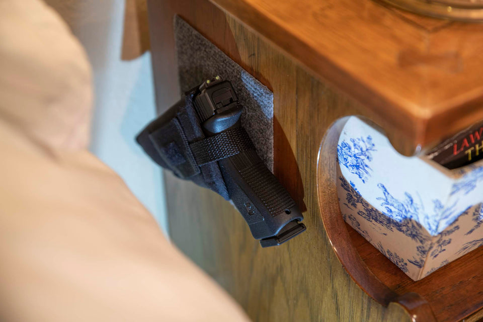 Kohroo Tactical Holster hanging on nightstand for quick emergency access