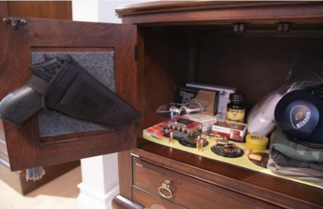 Kohroo Tactical Holster hanging in gun cabinet door