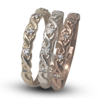 Ladies three band set sterling silver & 9k yellow and rose gold rings set with white cubic zirconia's