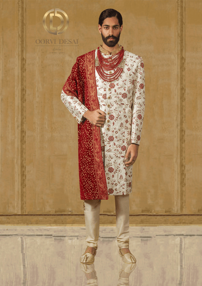 Pearl White Raw Silk Sherwani with Statement Red Dupatta at Oorvi Desai