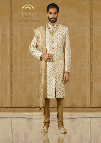 Cream & Gold Raw Silk Sherwani with Net Dupatta at Oorvi Desai London