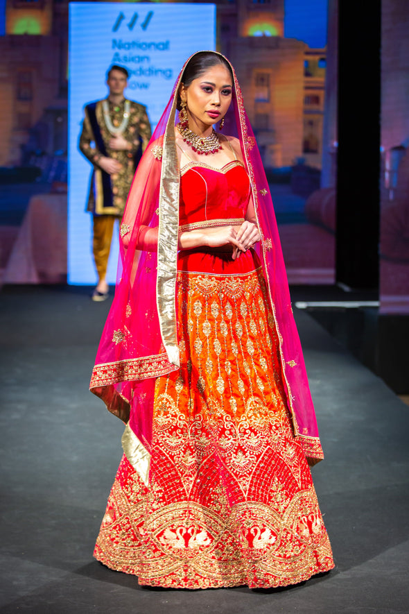 Fuchsia Pink and Orange Velvet Wedding Traditional Bridal lehenga with Pink Net Dupatta at Oorvi Desai