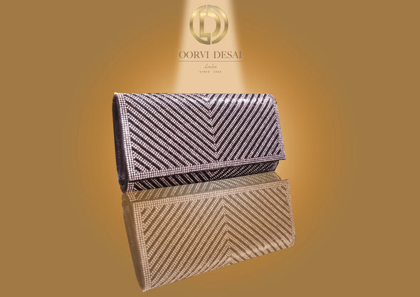 Diamond Studded Chevron Clutch by Oorvi Desai