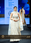 White and Fleece Gold Shimmer Wedding Reception Party Lehenga with Floral motifs at Oorvi Desai London