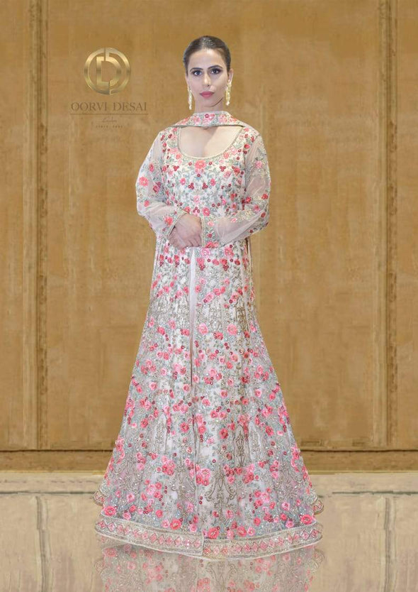 Peach Net jacket Lehenga with Rose Embroidery by Oorvi Desai
