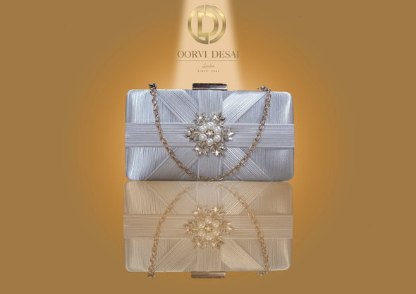 'Lustrous Criss-Cross Patterned Clutch with Pearl Brooch by Oorvi Desai' (OD - B 29  Gold/ Red/ Grey)