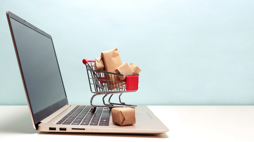Laptop with mini shopping cart on top