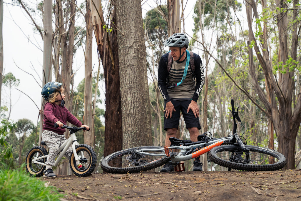 Balance biking with dad in the forest