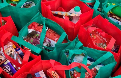 Red and green grocery bags filled with shopping