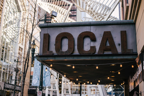 A restaurant sign reading 'Local' in uppercase letters