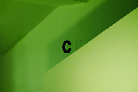 A bright green wall showing the letter 'C'