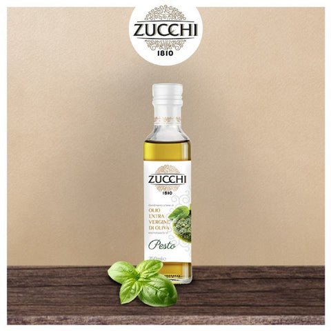 Extra Virgin Olive Oil Pesto Flavored on wood with basil leaf on a beige background