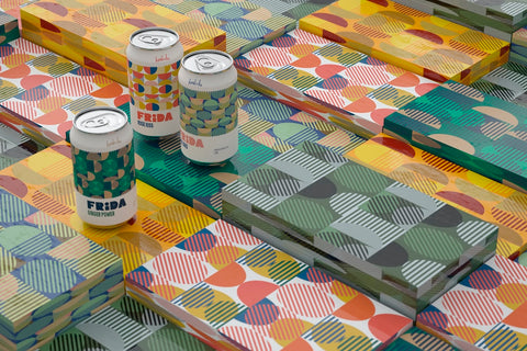 Colorful, patterned beverage cans with colorful, patterned wrapping paper