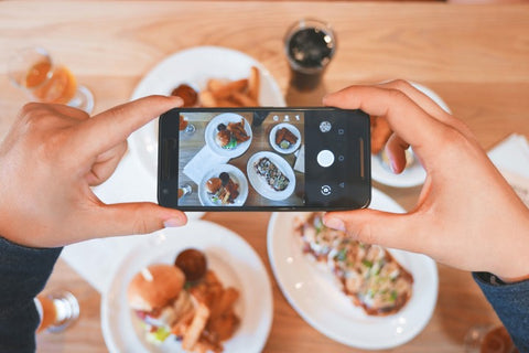 A women uploads a picture of her meal to social media