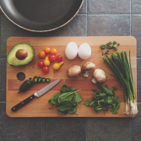 chopping board with healthy keto foods