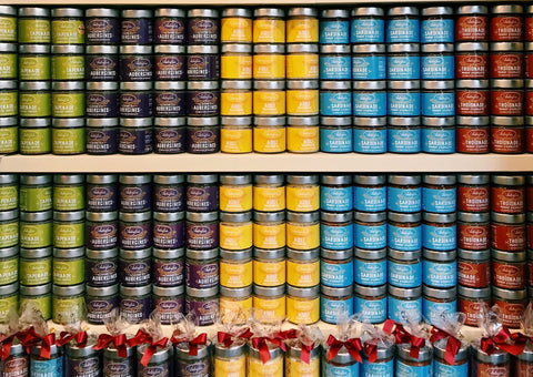 Shelves stacked with colored jars