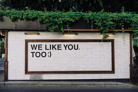 """A street art poster that says """"We like you too :)"""""""