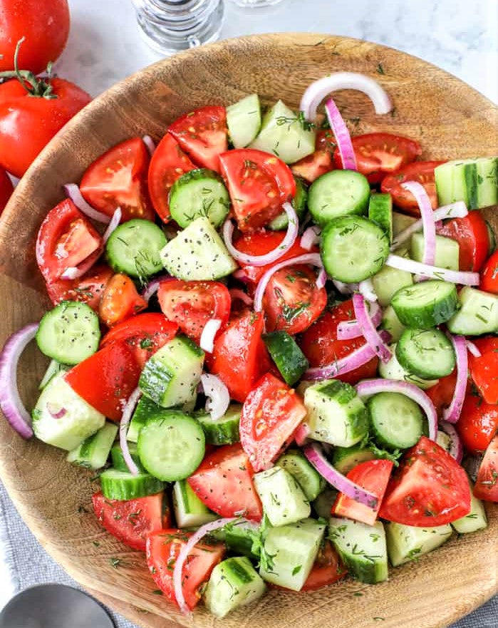 bowl full of cucumber and tomato salad