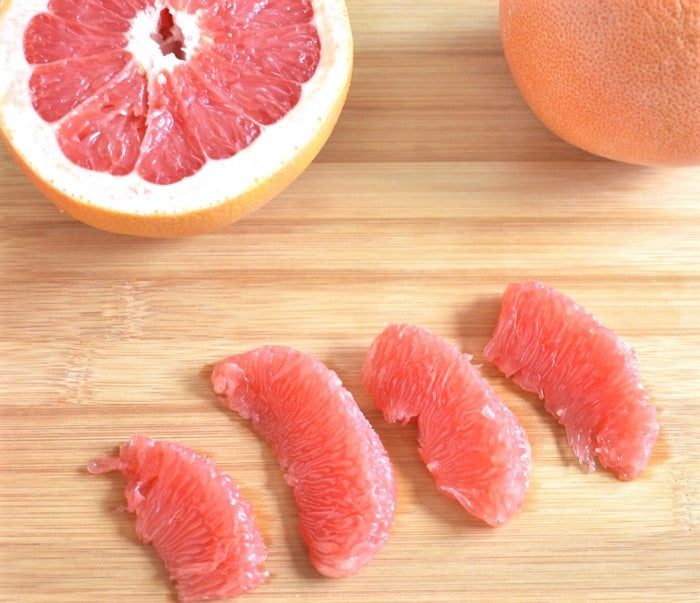 grapefruit segments cut of out of rind and laid on tabletop