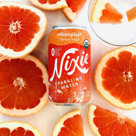 Grapefruit Sparkling Water, can, 12 oz, grapefruit halves in the background