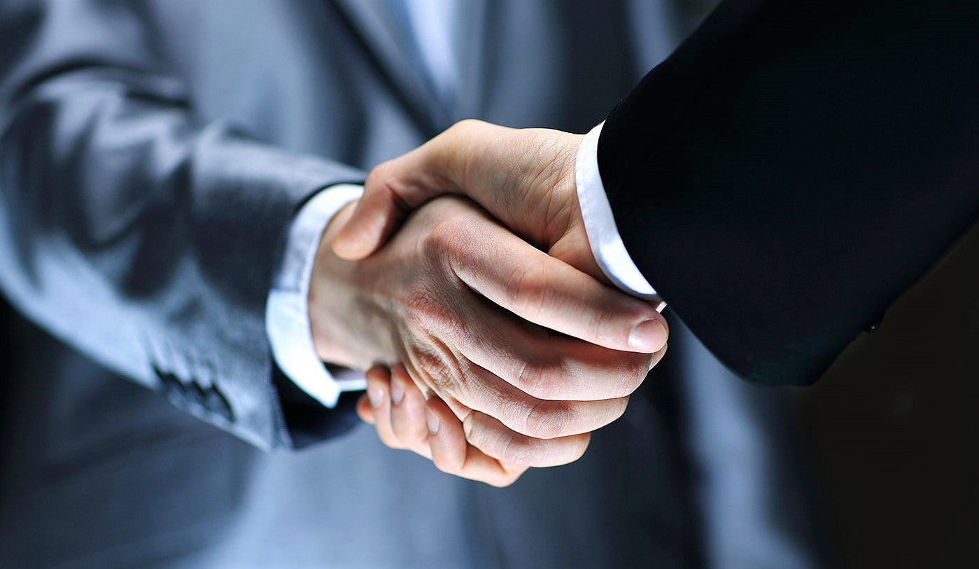 professional businessmen shaking hands to consolidate new restaurant opening