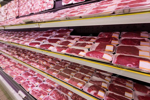 shelf full of frozen meat products in grocery store
