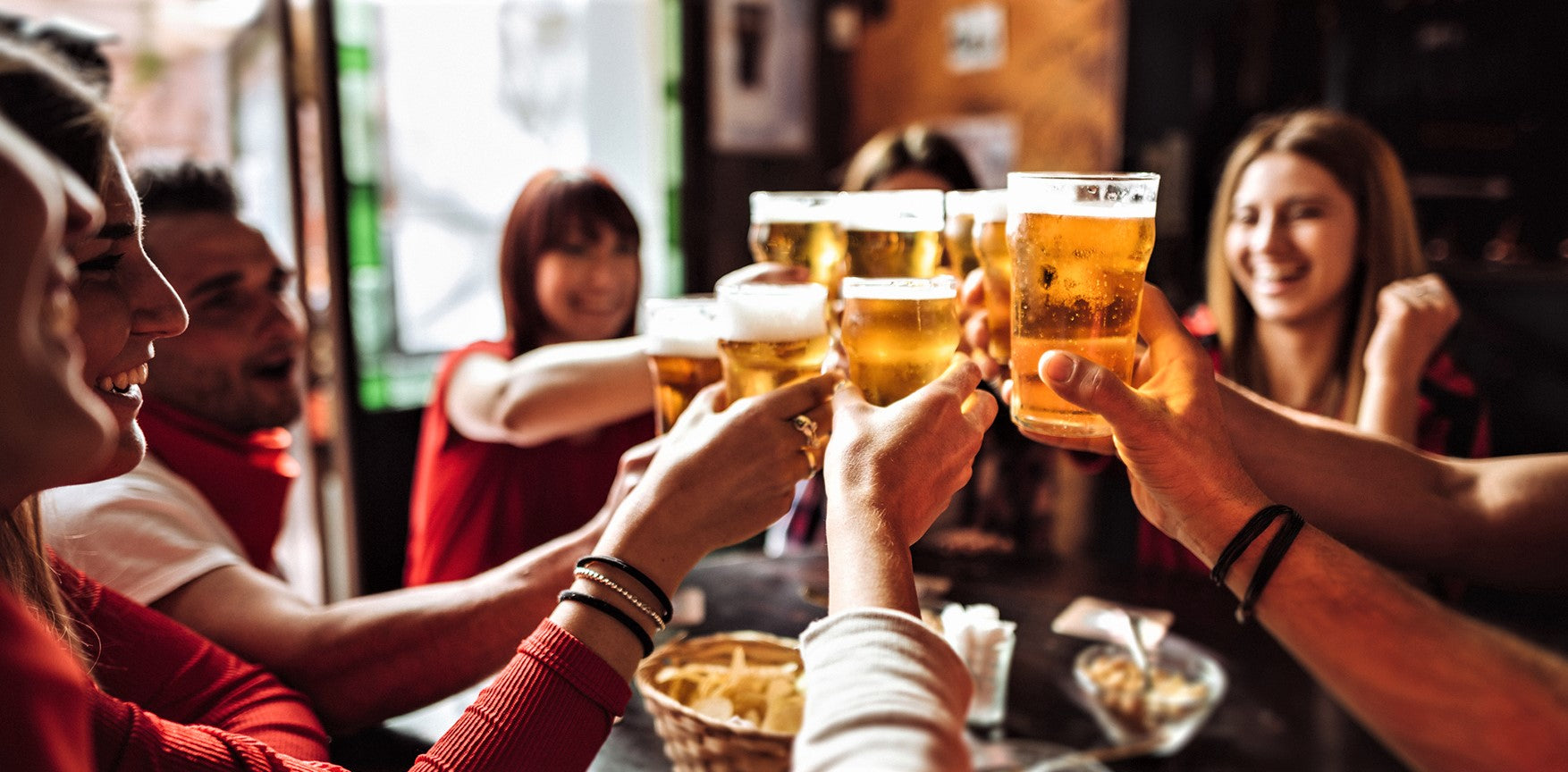 group of friends raise a toast during restaurant happy hour