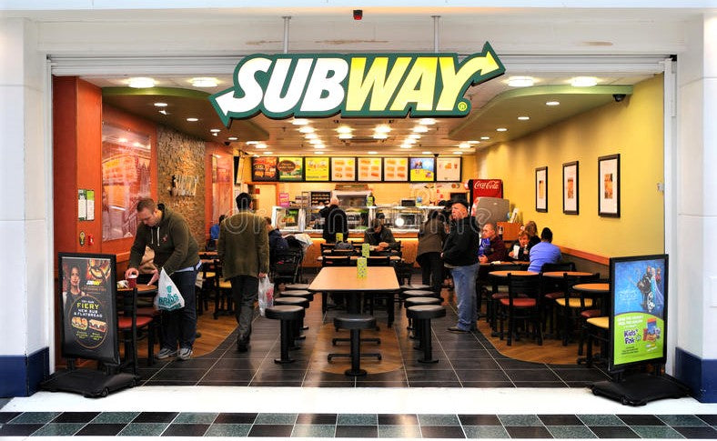 subway chain store inside shopping mall filled with people