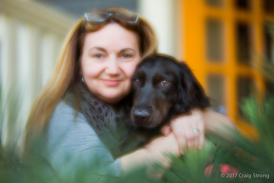 photo by Craig Strong woman with dog shot with Lensbaby Velvet 84 at F/1.8