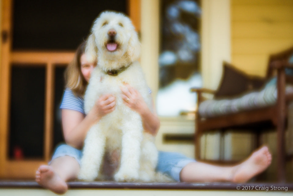 photo by Craig Strong woman with dog shot with Lensbaby Velvet 56 at F/1.6