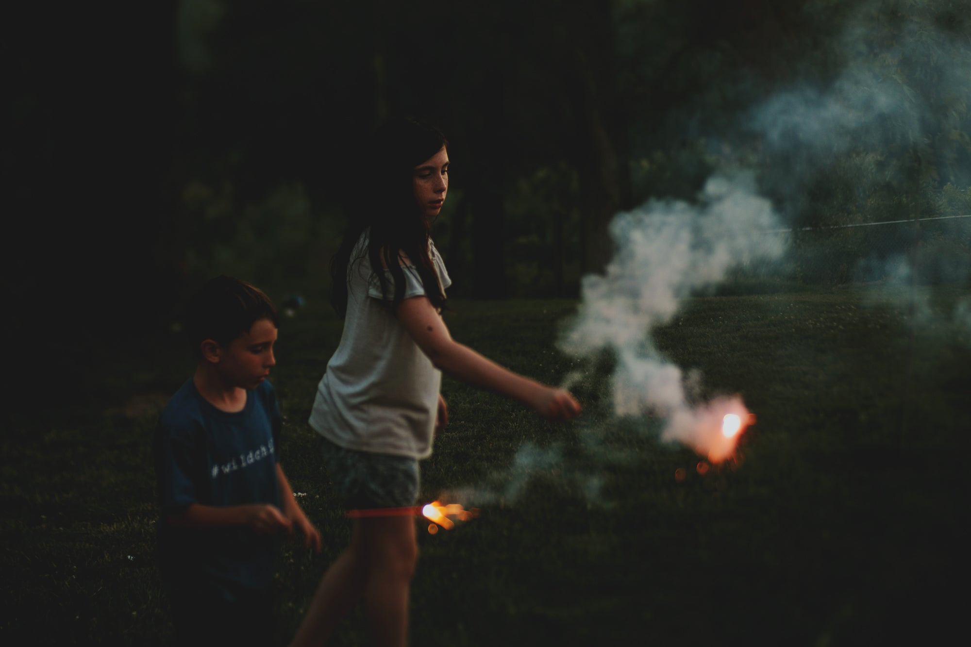 girl and boy play with smoking fireworks looking nervous journey story amy cyphers