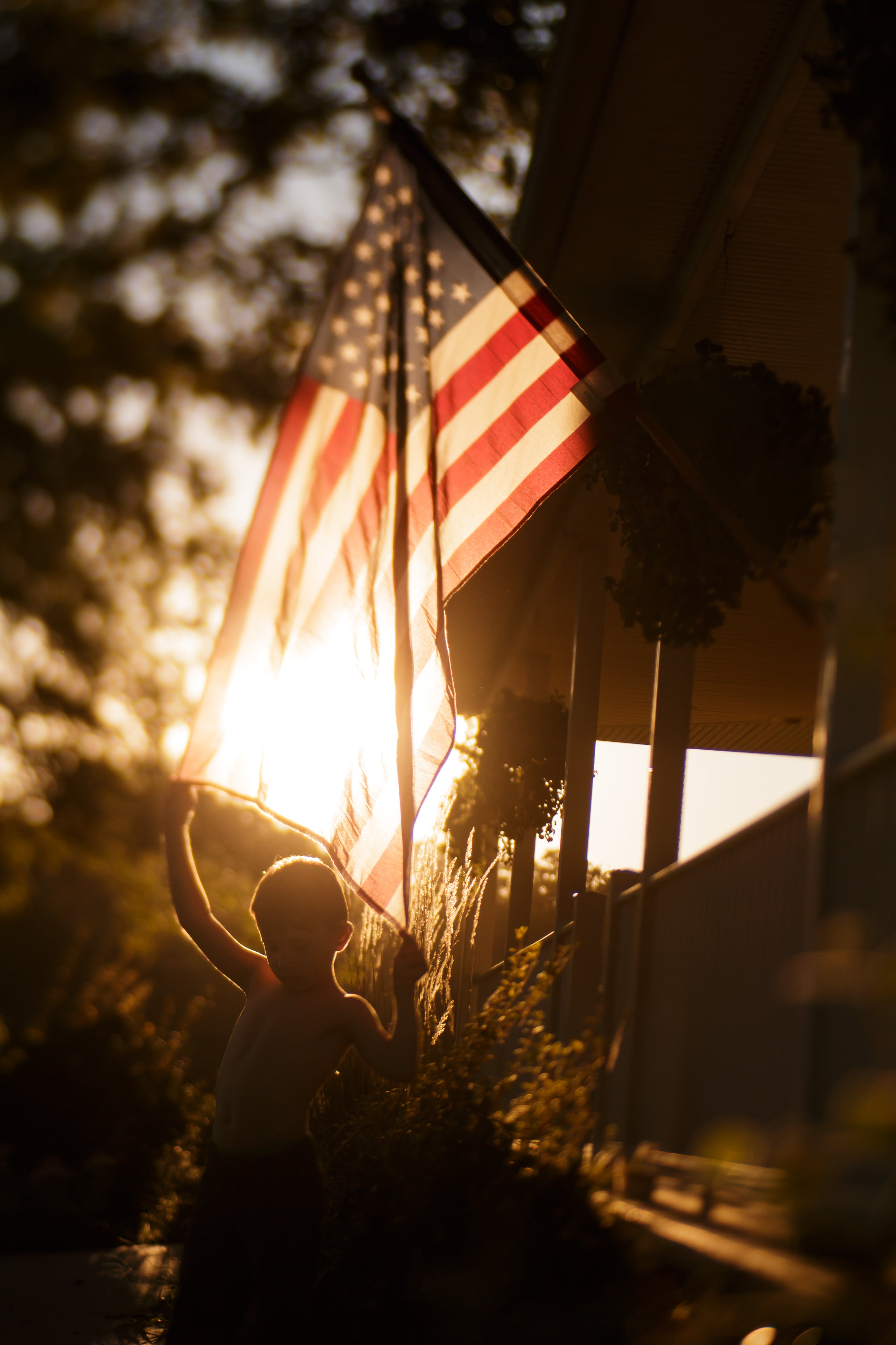 american flag and boy sunlight sunset journey story amy cyphers